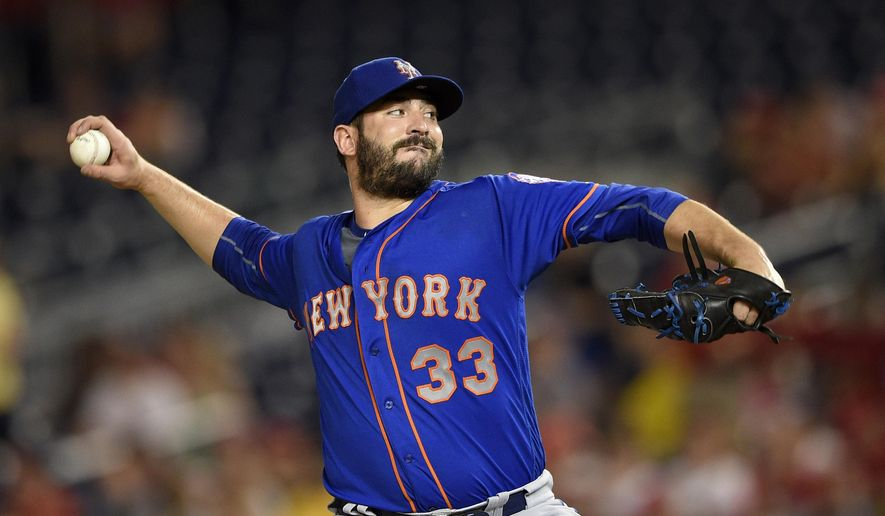 FILE - In this June 28, 2016, file photo, New York Mets starting pitcher Matt Harvey delivers a pitch during the third inning of a baseball game against the Washington Nationals, in Washington. Washington outfielder Bryce Harper, Chicago Cubs pitcher Jake Arrieta, New York Mets pitchers Matt Harvey and Jacob deGrom, and Baltimore third baseman Manny Machado were among 146 players eligible to exchange salary arbitration figures with their teams, though most were expected to reach agreements.(AP Photo/Nick Wass, File)