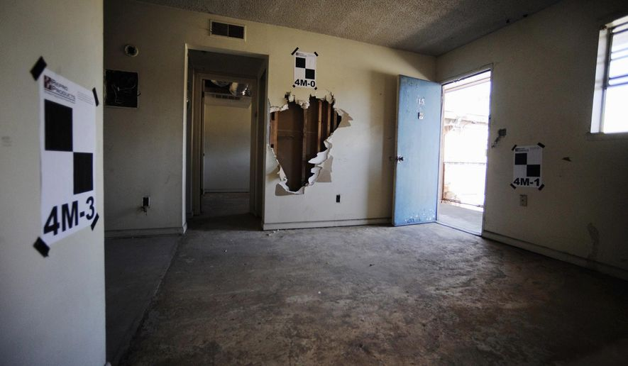 This photo taken Monday, Jan. 9, 2017, shows the suite once used by the Rev. Martin Luther King Jr. at the now-abandoned A.G. Gaston Motel in Birmingham, Ala. The motel will be renovated as the city's civil rights district joins the National Park Service under a proclamation signed by President Barack Obama on Thursday, Jan. 12. (AP Photo/Jay Reeves)