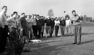 "FILE - In this March 12, 1962 file photo, John Jacobs demonstrates with the driver during the three-day golfing course for young amateur golfers at Sandy Lodge Club, Hertfordshire, England. John Jacobs, the captain of the first European Ryder Cup team and a tour official on the continent, has died. He was 91. The European Tour announced the death of its ""founding father"" on Friday, Jan. 13, 2017. A cause was not provided. (PA via AP, file)"