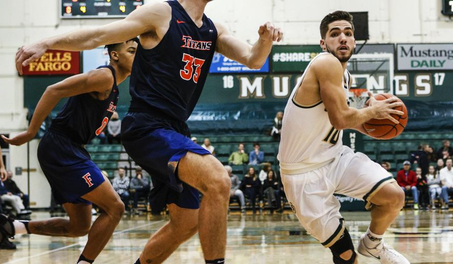 Cal Poly's Ridge Shipley, right, drives to the basket against Cal State Fullerton's Darcy Malone during an NCAA college basketball game in San Luis Obispo, Calif., Thursday, Jan. 12, 2017. (Joe Johnston/The Tribune (of San Luis Obispo via AP)
