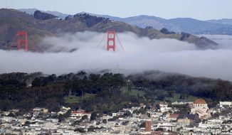 Fog enshrouds part of the The Golden Gate Bridge Friday, Jan. 13, 2017, in San Francisco. Sunshine and fog returned to some areas of Northern California after a series of storms which caused flooding in various cities. (AP Photo/Marcio Jose Sanchez)