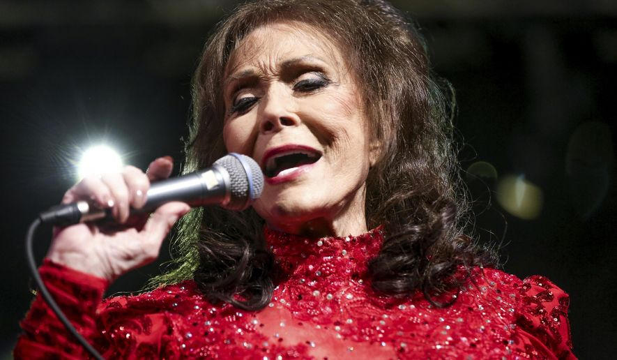 FILE - In this March 17, 2016 file photo, Loretta Lynn performs at the BBC Music Showcase at Stubb's during South By Southwest in Austin, Texas. The Country Music Hall of Fame and Museum will feature exhibits on Lynn, Faith Hill and Tim McGraw, Jason Aldean, and Shania Twain in 2017. The museum announced Friday, Jan. 13, 2017 their slate of exhibitions for the new year, which also includes a new exhibition called American Currents, focusing on music from 2016. (Photo by Rich Fury/Invision/AP)