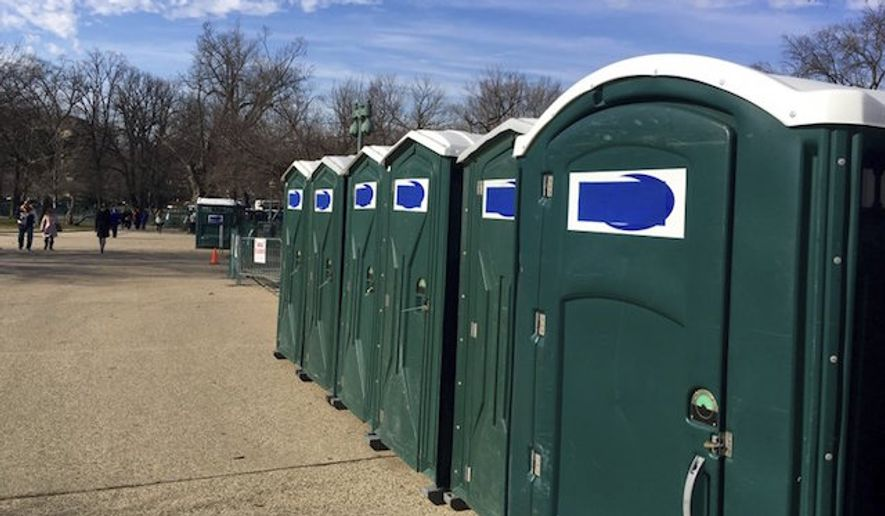 "Portable restrooms, with the name ""Don's Johns"" covered up, are lined up on Capitol Hill in Washington on Jan. 13, 2017. (Associated Press/Matthew Daly)"