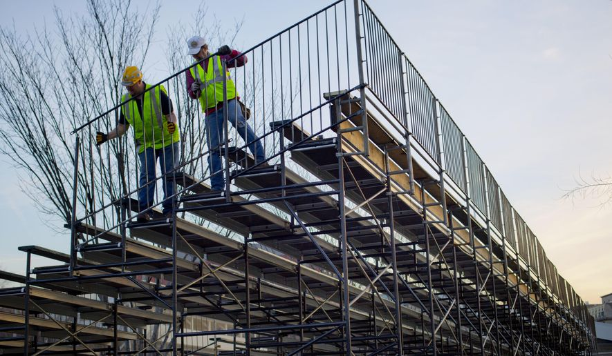 Workers install handrails for the bench seating along Pennsylvania Ave. in front of the White House in Washington, Friday, Jan. 13, 2017, as preparations continue for next week's Inauguration of President-elect Donald Trump. (AP Photo/Pablo Martinez Monsivais)