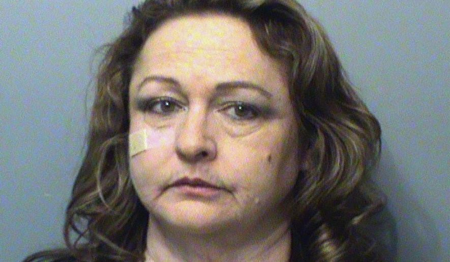 FILE - This Dec. 21, 2016, file booking photo provided by the Polk County Sheriff's Office in Des Moines, Iowa, shows Susan Ackerman, a former administrative law judge for Iowa Workforce Development. A court ruling issued Thursday, Jan. 12, 2017, upheld the firing of Ackerman who helped expose improper political pressure in Gov. Terry Branstad's administration, saying she lied to get her adult daughter state-funded health insurance. (Polk County Sheriff's Office via AP, File)