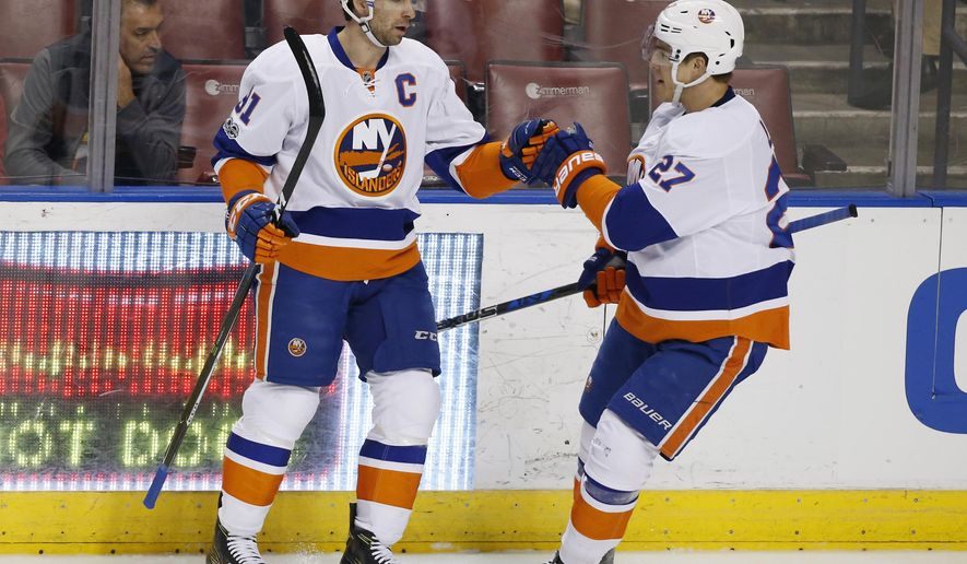 New York Islanders center John Tavares, left, is congratulated by left wing Anders Lee (27) after Tavares scored during the first period of an NHL hockey game against the Florida Panthers, Friday, Jan. 13, 2017, in Sunrise, Fla. (AP Photo/Wilfredo Lee)