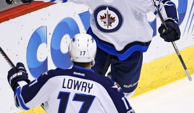 Winnipeg Jets center Shawn Matthias (16) celebrates his goal against the Arizona Coyotes with center Adam Lowry (17) during the first period of an NHL hockey game Friday, Jan. 13, 2017, in Glendale, Ariz. (AP Photo/Ross D. Franklin)