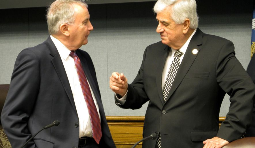Louisiana State University economist Jim Richardson, left, and Senate President John Alario, R-Westwego, both members of Louisiana's revenue forecasting panel, speak ahead of a meeting to downgrade the state's income projections on Friday, Jan. 13, 2017, in Baton Rouge, La. After the panel's actions, the state has an estimated $313 million budget deficit. (AP Photo/Melinda Deslatte)