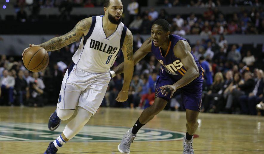 Dallas Mavericks Deron Williams drives the ball past Phoenix Suns Brandon Knight in the first half of their regular-season NBA basketball game in Mexico City, Thursday, Jan. 12, 2017. (AP Photo/Rebecca Blackwell)