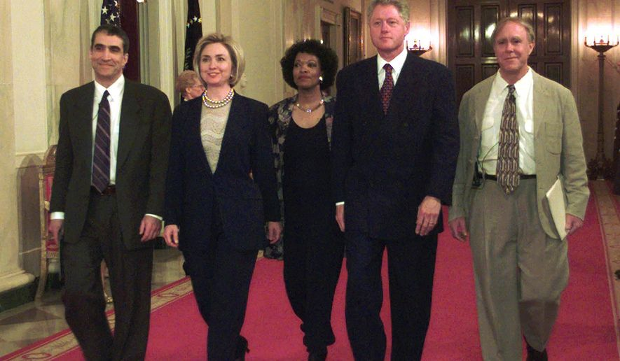 FILE - In this Wednesday, April 22, 1998 file photo, President Clinton and first lady Hillary Rodham Clinton walk down the State Floor hallway with Poets Laureate Robert Pinsky, left, Rita Dove, center, and Robert Haas, right, before the Millennium Evening Lecture at the White House in Washington. America's leading poets, including Pinsky and Dove, are averse to Donald Trump, and they have organized literary rallies in more than 30 states, which will be held on Sunday, Jan. 15, 2017, to say so. (AP Photo/Susan Walsh, File)