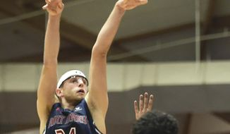 Saint Mary's forward Calvin Hermanson hits a shot in front of Portland guard Alec Wintering during the first half of an NCAA college basketball game in Portland, Ore., Thursday, Jan. 12, 2017. (AP Photo/Steve Dykes)
