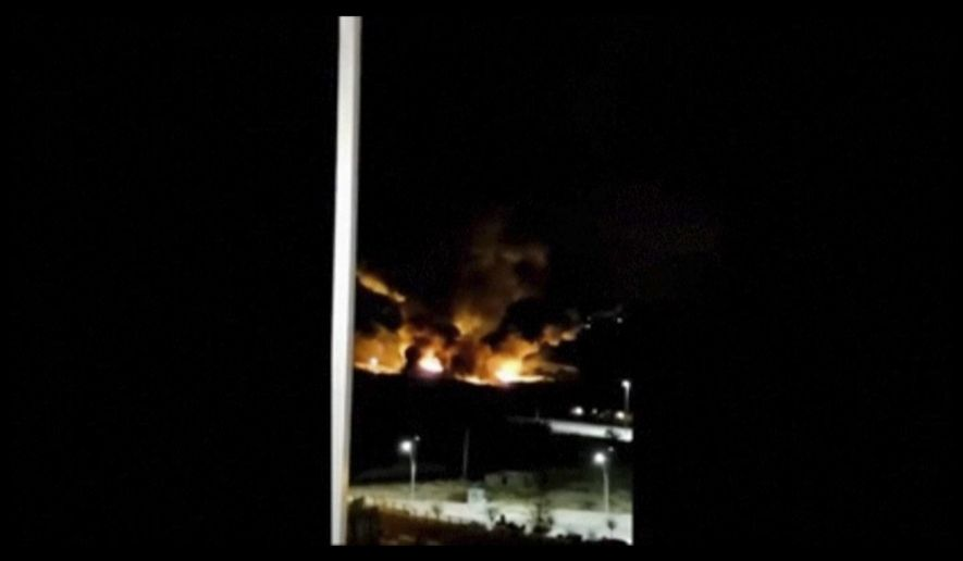 This image made from video shows the aftermath of an Israeli airstrike near a military airport west of Damascus, Syria on Friday, Jan. 13, 2016. Syria says Israel has launched missiles that hit near a military airport west of Damascus, triggering a fire. In a statement carried on the official news agency SANA, the military says the missiles were launched early on Friday and fell in the vicinity of the Mezzeh military airport. (Yomyat Kzefeh Hawen fi Dimashq via AP)