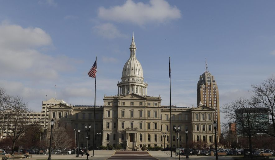 ADVANCE FOR SUNDAY, JAN. 15, 2017 - In this photo from Nov. 30, 2016 the State House is seen in Lansing, Mich. After commanding the legislative agenda for six years, Republicans say now is the time to finally enact a major tax cut for Michigan residents. The problem is it may be too late. GOP lawmakers pushing to gradually repeal the 4.25 percent personal income tax will confront some stark realities as they begin combing over state spending - namely, future budget pressures they themselves created. (AP Photo/Carlos Osorio, File)