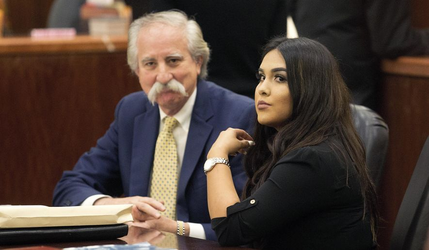 Alexandria Vera, a former Houston-area middle school teacher, sits with her attorney Ricardo Rodriguez as they wait for her hearing to begin, Friday, Jan. 13, 2017, in Houston. Vera, who pleaded guilty last year to having a long-term sexual relationship with a 13-year-old boy who impregnated her, was sentenced to 10 years in prison. (Bob Levey  /Houston Chronicle via AP)