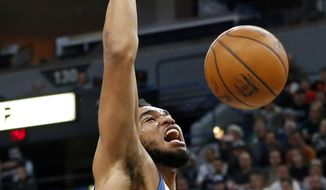 Minnesota Timberwolves' Karl-Anthony Towns dunks during the first quarter of the team's NBA basketball game against the Oklahoma City Thunder on Friday, Jan. 13, 2017, in Minneapolis. (AP Photo/Jim Mone)