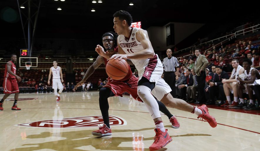 Stanford guard Dorian Pickens dribbles past Washington State guard K.J. Langston during the second half of an NCAA college basketball game Thursday, Jan. 12, 2017, in Stanford, Calif. (AP Photo/Marcio Jose Sanchez)