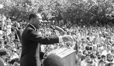 In this May 17, 1967 file photo, Dr. Martin Luther King speaks at the University of California administration building in Berkeley, Calif. (AP Photo, File)