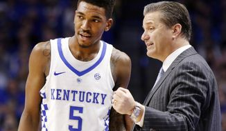Kentucky's Malik Monk (5) is instructed by head coach John Calipari during the second half of an NCAA college basketball game against Auburn, Saturday, Jan. 14, 2017, in Lexington, Ky.  (AP Photo/James Crisp)