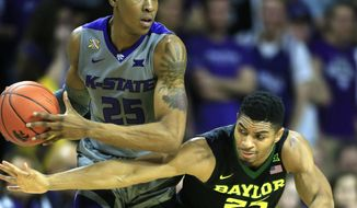 Baylor guard Al Freeman (25) reaches in on Kansas State forward Wesley Iwundu (25) during the first half of an NCAA college basketball game in Manhattan, Kan., Saturday, Jan. 14, 2017. (AP Photo/Orlin Wagner)