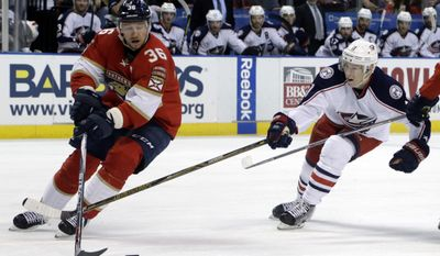 Florida Panthers left wing Jussi Jokinen (36) skates with the puck as Columbus Blue Jackets left wing Matt Calvert (11) defends during the second period of an NHL hockey game, Saturday, Jan. 14, 2017, in Sunrise, Fla. (AP Photo/Lynne Sladky)