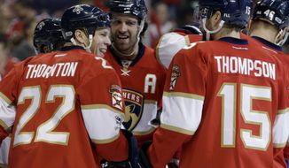Florida Panthers left wing Shawn Thornton (22) smiles with right wing Paul Thompson (15) after scoring a goal during the first period of an NHL hockey game against the Columbus Blue Jackets, Saturday, Jan. 14, 2017, in Sunrise, Fla. (AP Photo/Lynne Sladky)