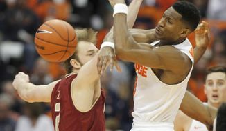 Syracuse's Andrew White III, right, and Boston College's Connor Tava, left, battle for a rebound in the second half of an NCAA college basketball game in Syracuse, N.Y., Saturday, Jan. 14, 2017.  (AP Photo/Nick Lisi)