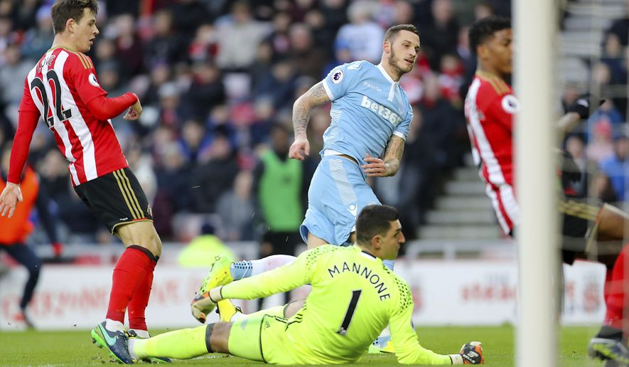 Stoke City's Marko Arnautovic, center, watches the ball go in as he scores his side's second goal of the match during their English Premier League soccer match against Sunderland at The Stadium of Light, Sunderland, England, Saturday, Jan. 14, 2017. (Owen Humphreys/PA via AP)