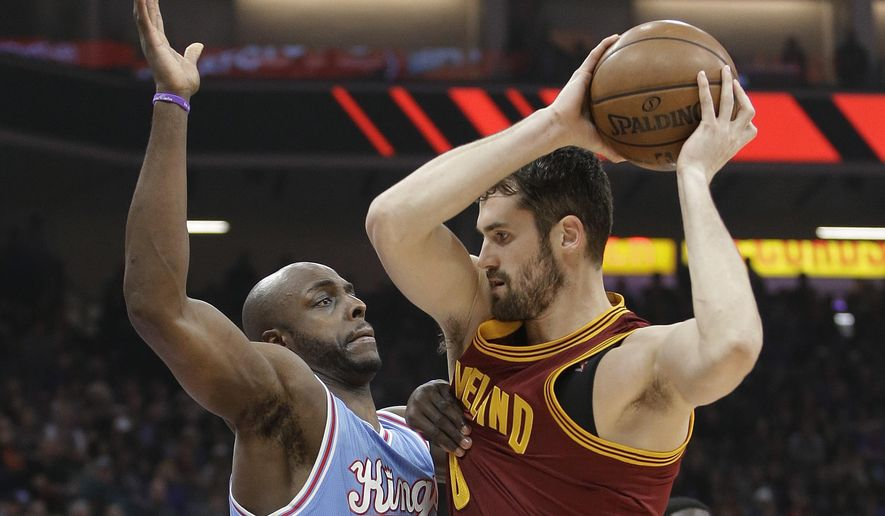 Sacramento Kings forward Anthony Tolliver, left, guards Cleveland Cavaliers forward Kevin Love during the first quarter of an NBA basketball game Friday, Jan. 13, 2017, in Sacramento, Calif. (AP Photo/Rich Pedroncelli)