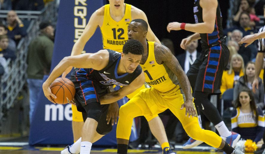 DePaul guard Billy Garrett Jr., left, is defended by Marquette guard Duane Wilson, right, during the first half of an NCAA college basketball game Saturday, Jan. 14, 2017, in Milwaukee. (AP Photo/Darren Hauck)