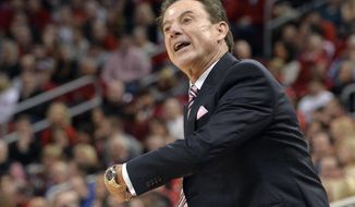 Louisville coach Rick Pitino shouts instructions to his team during the first half of an NCAA college basketball game against Duke, Saturday, Jan. 14, 2017, in Louisville, Ky. (AP Photo/Timothy D. Easley)