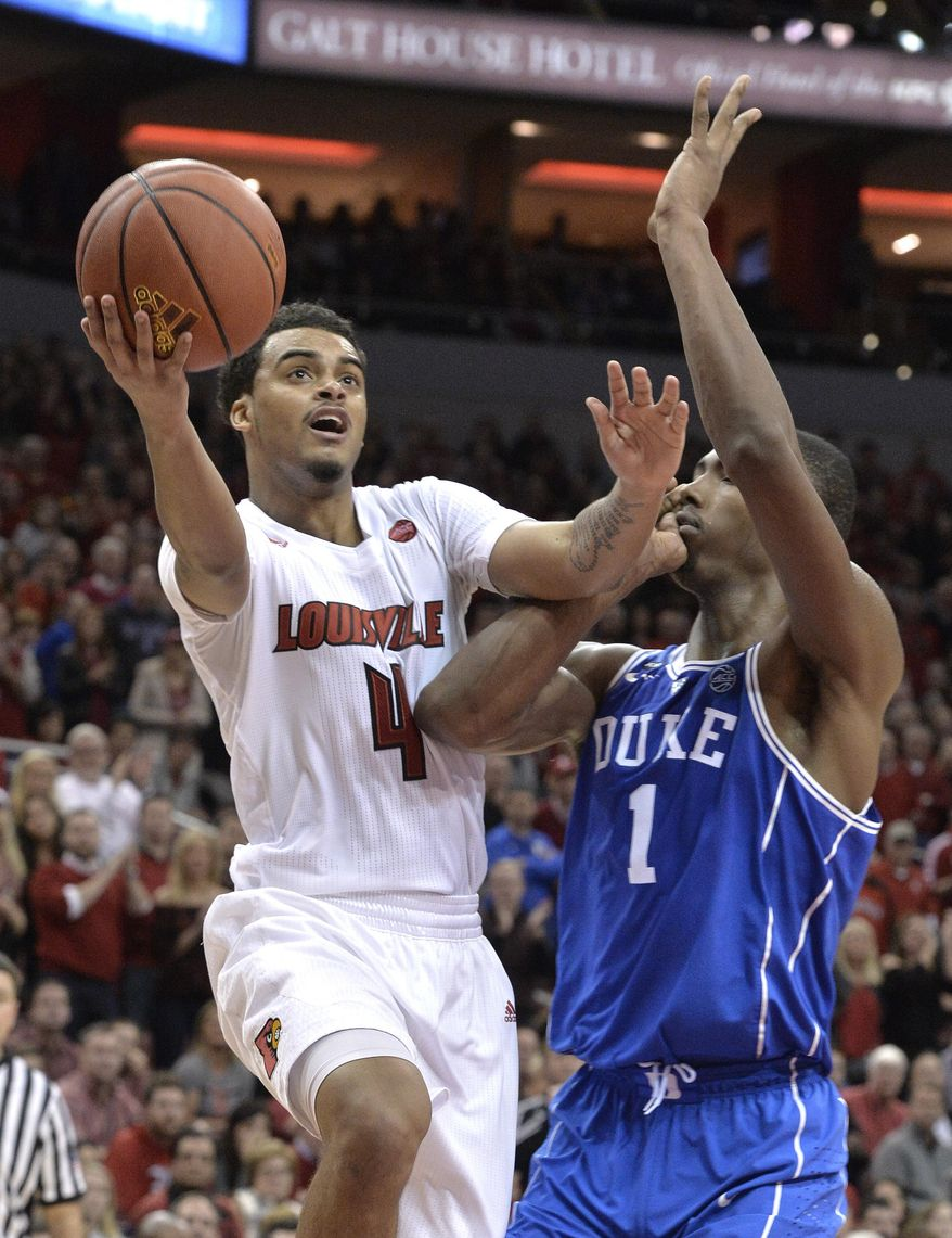 Louisville's Quentin Snider (4) shoots past the defense of Duke's Harry Giles (1) during the second half of an NCAA college basketball game, Saturday, Jan. 14, 2017, in Louisville, Ky. Louisville won 78-69. (AP Photo/Timothy D. Easley)