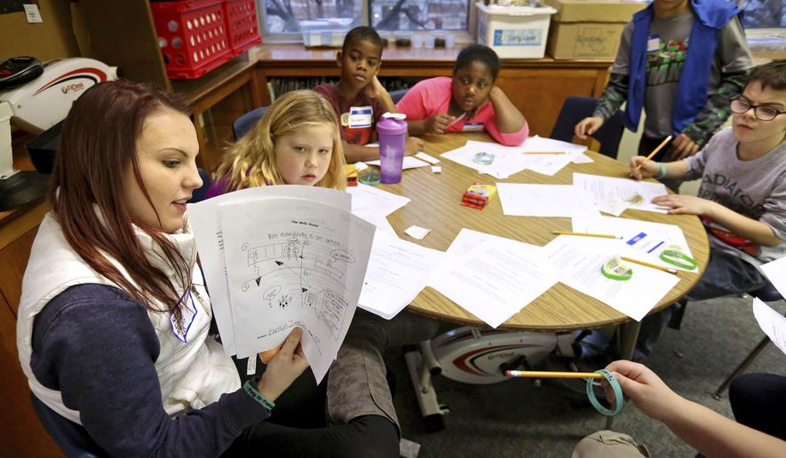 ADVANCE FOR WEEKEND EDITIONS - In this Tuesday, Jan. 10, 2017, photo, Dubuque student Kaetlyn Little, left, speaks with fourth-grade students at Fulton Elementary School in Dubuque, Iowa. Dubuque students were at Fulton to promote anti-bullying efforts as part of their J-Term course. (Jessica Reilly/Telegraph Herald via AP)