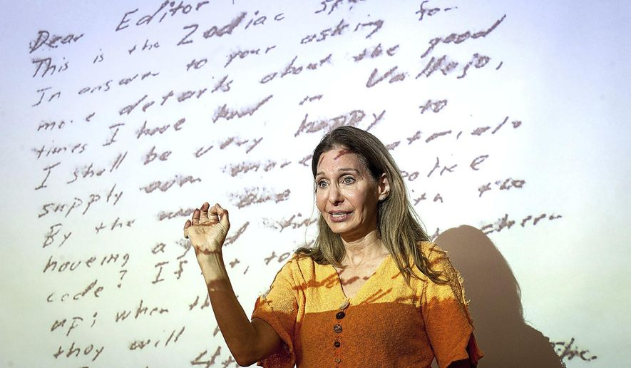 In this Nov. 30, 2016 photo, noted handwriting expert Michelle Dresbold of Pittsburgh's East End discusses a letter writted by the unidentified Zodiak Killer with members of the Students Conquering Cold Cases Club at the University of Pittsburgh, in Pittsburg.  (Stephanie Strasburg /Pittsburgh Post-Gazette via AP)