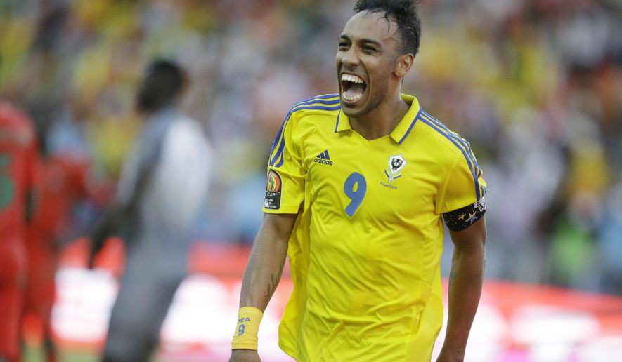 Gabon's Pierre Emerick Aubameyang celebrates after scoring against Guinea Bissau during their African Cup of Nations Group A soccer match between Gabon and Guinea Bissau at the Stade de l'Amitie, in Libreville, Gabon Saturday Jan. 14, 2017. (AP Photo/Sunday Alamba)