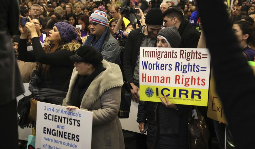 "Demonstrators gather for a rally supporting immigrant rights,  Saturday, Jan. 14, 2017 in Chicago. Immigrant rights advocates are planning demonstrations across the country in what they're calling a ""first salvo"" against President-elect Donald Trump's pledged hard line on immigration.   (Abel Uribe/Chicago Tribune via AP)"