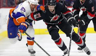 Carolina Hurricanes' Lee Stempniak (21) battles with New York Islanders' Jason Chimera (25) during the first period of an NHL hockey game, Saturday, Jan. 14, 2017, in Raleigh, N.C. (AP Photo/Karl B DeBlaker)