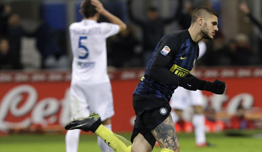 Inter Milan's Mauro Icardi, right, celebrates after scoring his side first goal during a Serie A soccer match between Inter Milan and Chievo, at the San Siro stadium in Milan, Italy, Saturday, Jan. 14, 2017. (AP Photo/Luca Bruno)