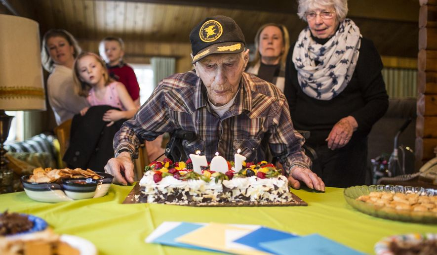 "Leonard Ross blows out the candles Sunday while celebrating his 107th birthday with family and neighbors at his cabin in Moran, where he has lived since 1972. ""I've been to Canada. I've been to the east coast and I've been to the west coast. Las Vegas is as far south as I've ever been, but I don't know of any place I'd rather be than right here,"" he said. (Ryan Dorgan/Jackson Hole News & Guide via AP)"