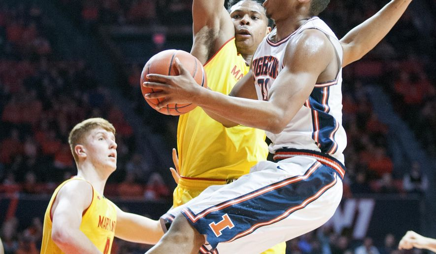 Illinois' guard Malcolm Hill (21) is guarded by Maryland's forward L.G. Gill (10) during their NCAA college basketball game in Champaign, Ill., Saturday, Jan. 14, 2017. (AP Photo/Robin Scholz)