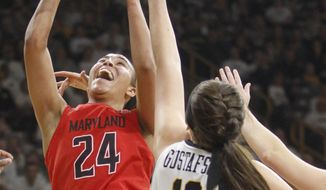 Maryland's Stephanie Jones (24) goes to the basket against Iowa's Megan Gustafson (10) during the first half of an NCAA college basketball game, Saturday, Jan. 14, 2017, in Iowa City, Iowa. (AP Photo/Matthew Holst)
