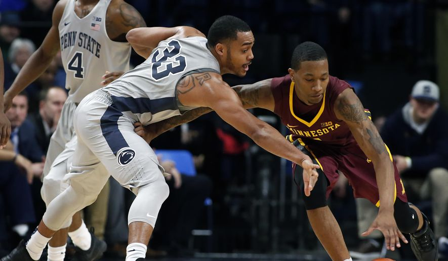Penn State's Shepp Garner (33) goes for the steal on Minnesota's Deividas Zemgulis (1) during the first half of an NCAA college basketball game in State College, Pa., Saturday, Jan. 14, 2017. (AP Photo/Chris Knight)