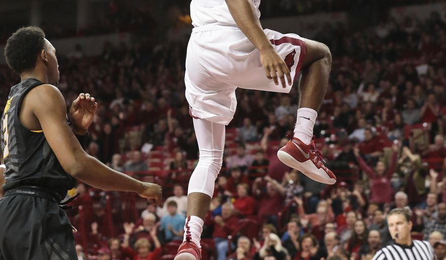 Arkansas' guard Daryl Macon (4) finishes a fast break during the first half of an NCAA college basketball game against Missouri, Saturday, Jan. 14, 2017, in Fayetteville, Ark. (AP Photo/Chris Brashers)