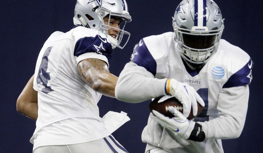 FILE - In this Wednesday, Jan. 11, 2017, file photo, Dallas Cowboys running back Ezekiel Elliott (21) takes the handoff from quarterback Dak Prescott (4) during NFL football practice at the team's headquarters in Frisco, Texas. Aaron Rodgers has been unbeatable on a seven-game run that carried the Green Bay Packers to a divisional-round game against Dallas. So was Cowboys rookie Dak Prescott for 11 straight in the regular season, giving him the No. 1 seed for his playoff debut Sunday. (AP Photo/LM Otero, File)