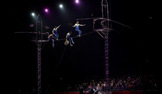 """A Ringling Bros. and Barnum & Bailey high wire act performs Saturday, Jan. 14, 2017, in Orlando, Fla. The Ringling Bros. and Barnum & Bailey Circus will end the """"The Greatest Show on Earth"""" in May, following a 146-year run of performances. Kenneth Feld, the chairman and CEO of Feld Entertainment, which owns the circus, told The Associated Press, declining attendance combined with high operating costs are among the reasons for closing. (AP Photo/Chris O'Meara)"""
