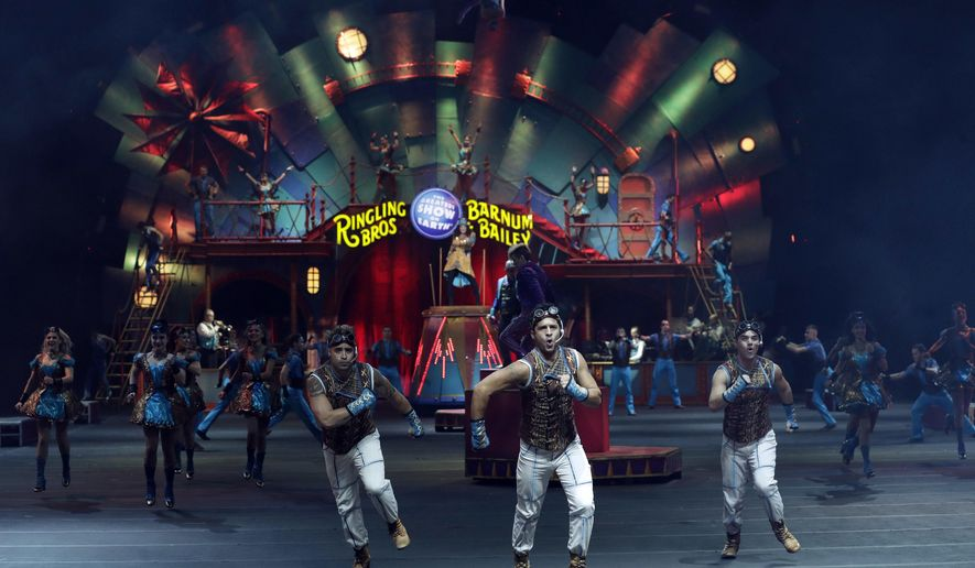 "Ringling Bros. and Barnum & Bailey performers are seen during a show Saturday, Jan. 14, 2017, in Orlando, Fla. The Ringling Bros. and Barnum & Bailey Circus will end the ""The Greatest Show on Earth"" in May, following a 146-year run of performances. Kenneth Feld, the chairman and CEO of Feld Entertainment, which owns the circus, told The Associated Press, declining attendance combined with high operating costs are among the reasons for closing. (AP Photo/Chris O'Meara)"