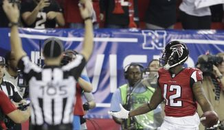 Atlanta Falcons wide receiver Mohamed Sanu (12) celebrates his touchdown against the Seattle Seahawks during the second half of an NFL football divisional football game, Saturday, Jan. 14, 2017, in Atlanta. (AP Photo/David Goldman)