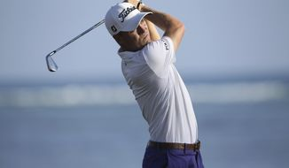 Justin Thomas follows his shot on the 17th tee box during the second round of the Sony Open golf tournament, Friday, Jan. 13, 2017, in Honolulu. (AP Photo/Marco Garcia)