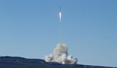 Space-X's Falcon 9 rocket successfully launches with 10 satellites into orbit for Iridium Communications Inc., at Vandenberg Air Force Base, Calif., Saturday, Jan. 14, 2017. About nine minutes later, the first stage returned to Earth and landed successfully on a barge in the Pacific Ocean south of Vandenberg. The return to flight is an important step for SpaceX, a California-based company that has about 70 launches in line, worth more than $10 billion. (Matt Hartman via AP)