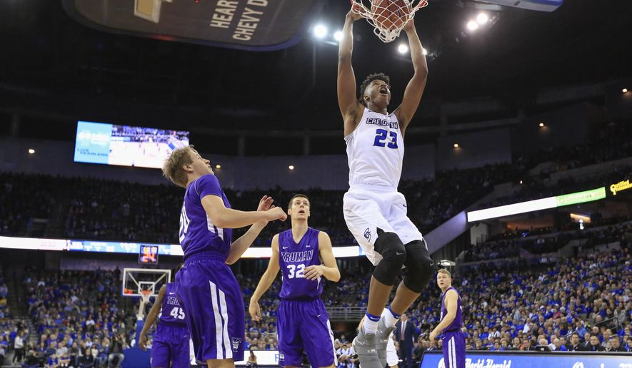 Creighton's Justin Patton (23) dunks as Truman State's Dwight Sistrunk Jr. (45), Jack Green, second left, Connor Erickson (32) and Nathan Messer, right, watch, during the first half of an NCAA college basketball game in Omaha, Neb., Saturday, Jan. 14, 2017. (AP Photo/Nati Harnik)