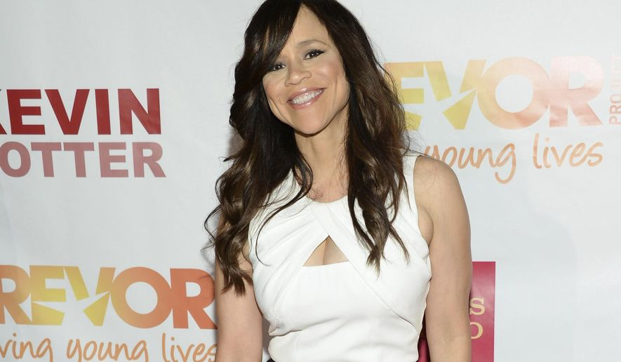 FILE - In this June 15, 2015 file photo, actress Rosie Perez attends TrevorLIVE New York to benefit The Trevor Project at the Marriott Marquis, in New York. Perez will join New York Mayor Bill de Blasio, the Rev. Al Sharpton and other celebrities including Mark Ruffalo,  and Michael Moore are planning to rally New Yorkers to stand up to President-elect Donald Trump on the eve of his inauguration, organizers said Saturday. (Photo by Evan Agostini/Invision/AP, File)